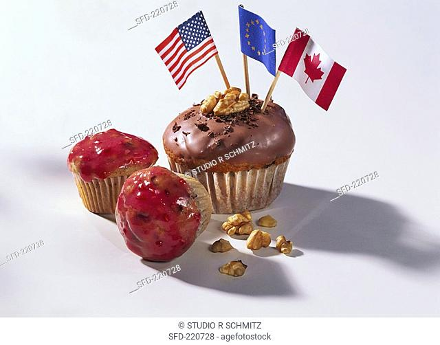Muffin with chocolate icing & flag, muffin with pink icing 1