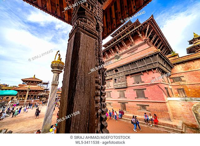 Kathmandu, Nepal - September 21 2019: People walking around Patan Durbar Square, a UNESCO Heritage site in Nepal. Temples reconstruction after Earthquake