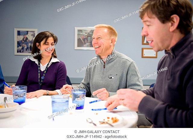 NASA astronauts Nicole Stott, Tim Kopra (center) and Michael Barratt, all STS-133 mission specialists, participate in a food tasting session in the Habitability...