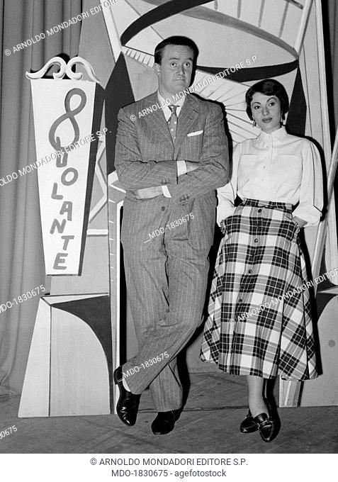 Italian actor and TV host Galeazzo Benti (Galeazzo Bentivoglio) and Italian actress and showgirl Flora Lillo (Flora Angiolillo) posing on the set of TV variety...