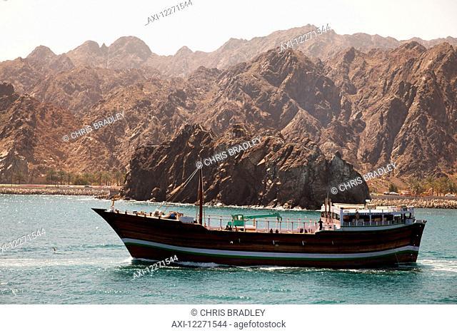 Ocean-going dhow, leaving Mutrah harbour; Muscat, Oman
