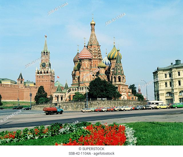 Cars parked in front of a church, St. Basil's Cathedral, Moscow, Russia
