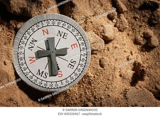Compass with a cross as a pointer