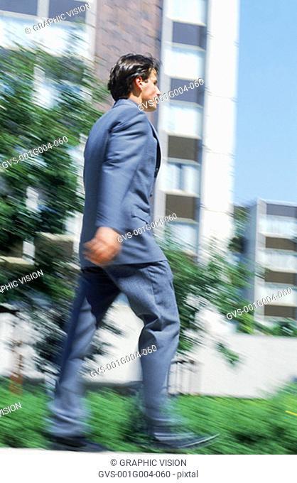 Young businessman walking