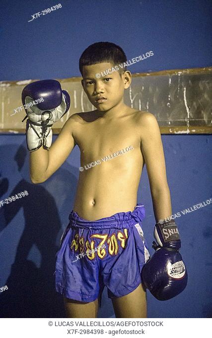 Khunsenk, 13 year old, Muay Thai boxer preparing hands, Bangkok, Thailand