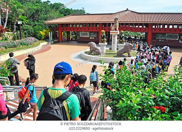 Okinawa, Japan: young students visiting the Okinawa World theme park