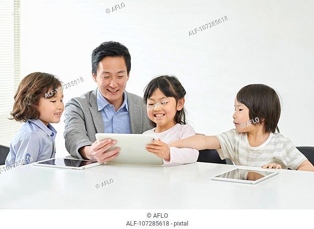 Japanese elementary school kids with teacher