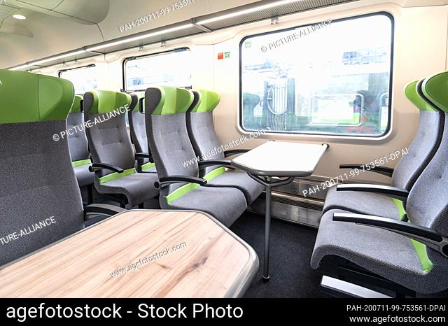 10 July 2020, North Rhine-Westphalia, Aachen: A large capacity car from the company Flixtrain. The cars of the Flixbus sister company were renovated during the...