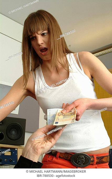 Angry young woman complaining about too little money