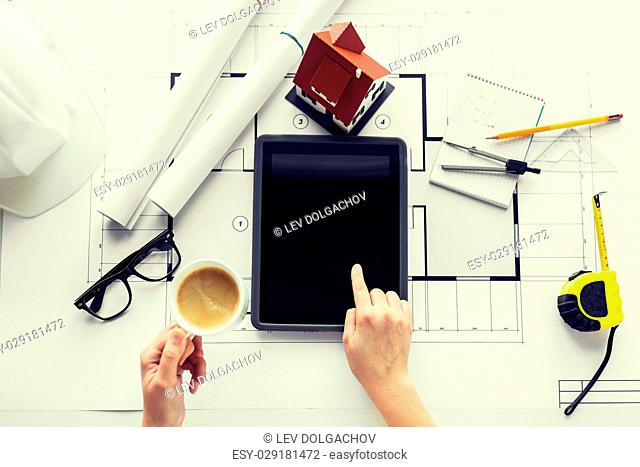 business, architecture, building, construction and people concept - close up of architect hand with living house blueprint and tablet pc computer