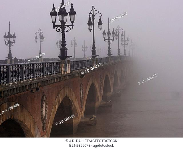 "France. Nouvelle Aquitaine. Gironde. ""Pont de pierre"" bridge in the fog, at Bordeaux"