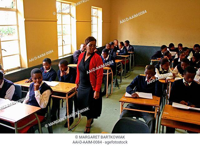 School teacher with school children in classroom, St Mark's School, Mbabane, Hhohho, Kingdom of Swaziland