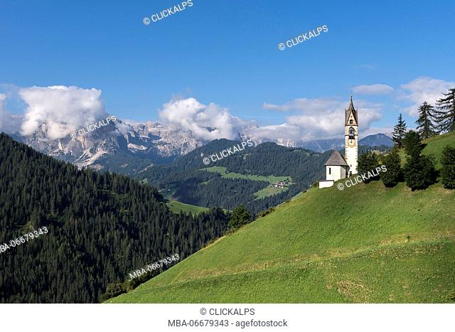 La Val/Wengen, Dolomites, South Tyrol, Italy. The Church of Santa Barbara in La Val with the Puez mountain Group in the background