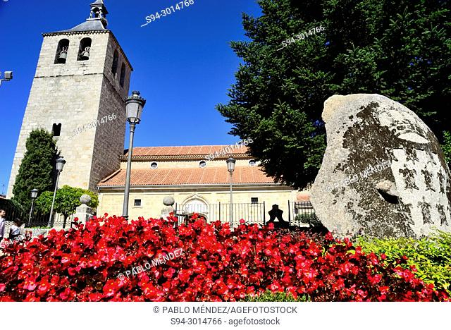 Church of Our Lady of Asunción and flowers in Galapagar, Madrid, Spain