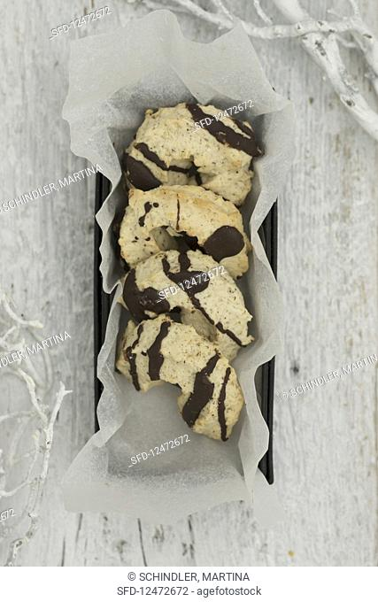 Piped biscuits with chocolate glaze in a box