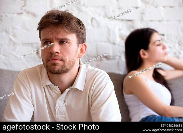 Upset millennial man think about relationship problems, having fight with proud female lover, offended couple not talking after family quarrel
