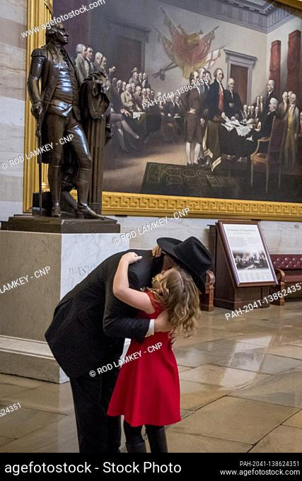 United States Representative-elect Troy Nehls (Republican of Texas) hugs his eight year-old daughter Tori Nehls in the Rotunda at the U.S