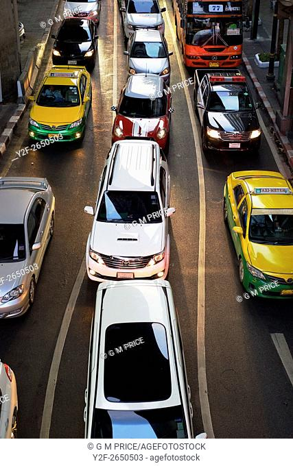 elevated view of cars lined up at traffic lights, near Silom shopping centre