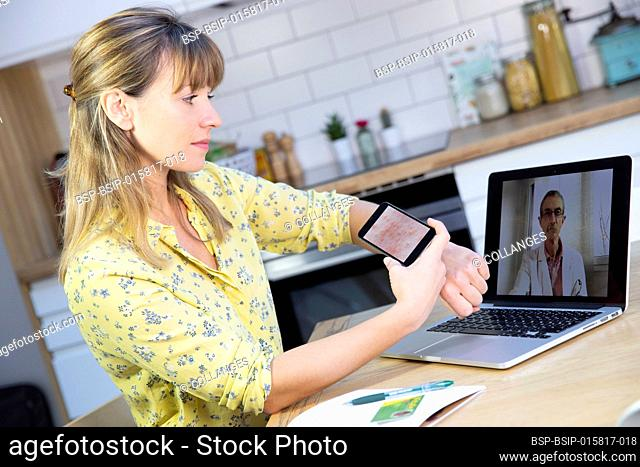 A video consultation between a young woman and her GP for a heat rash that she has taken a photo of using her mobile