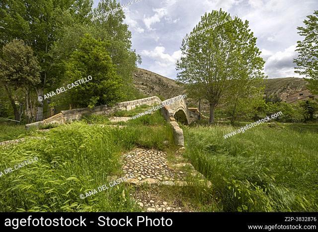 Miravete de la Sierra old village in Maestrazgo county Teruel Aragon Spain Medieval stone architecture. The stone bridge