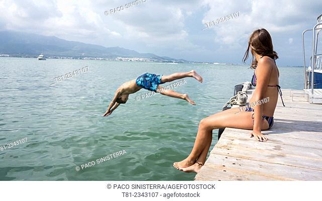 by jumping boy and girl watching sea, San Carlos de la Rapita, Tarragona