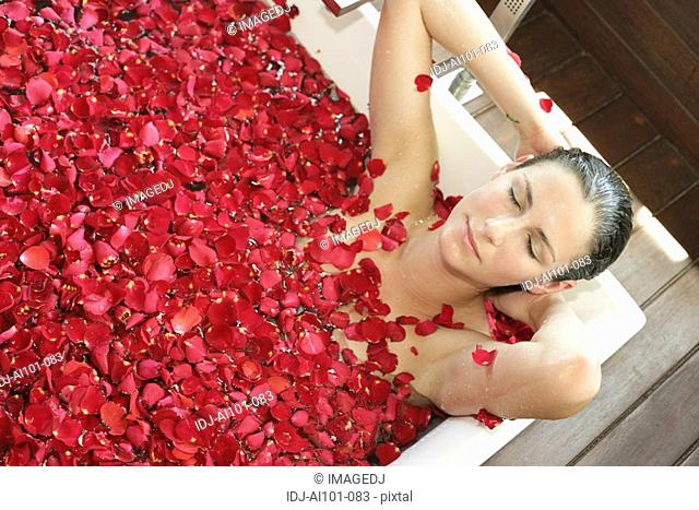A young woman having aromatherapy bath