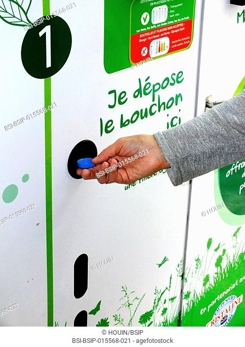Plastic bottle recycling machine in a supermarket. A 1 centime (euros) token is given for each returned bottle