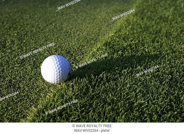 Golf ball on organic golf course, Canada, Manitoba, Riding Mountain National Park