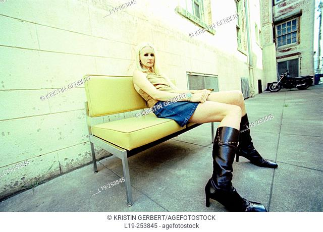 Young pretty woman sitting on bench