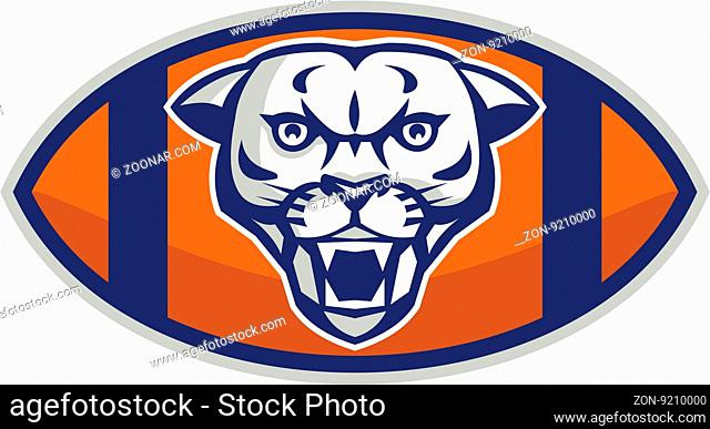 Illustration of a cougar mountain lion head viewed from front set inside american football ball oval shape done in retro style