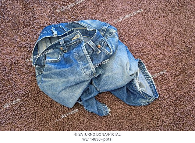 blue jeans on the floor