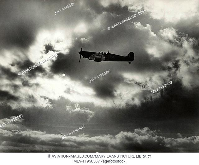 RAF Supermarine Spitfire Mark1 Flying Past Cloud and the Sun During the Battle-Of-Britain