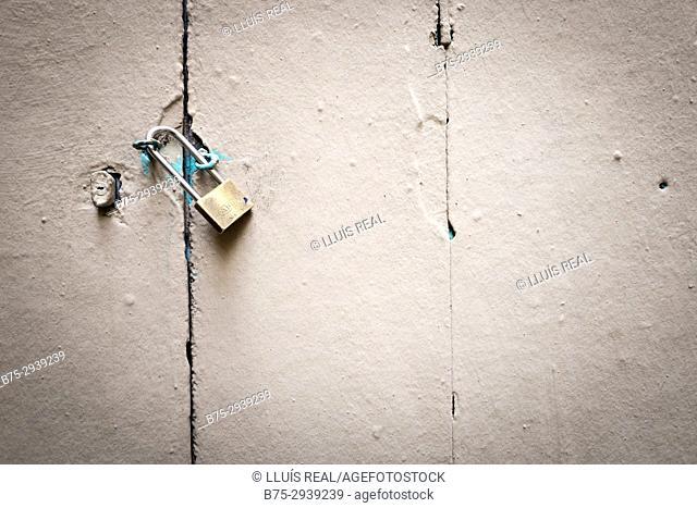 Old door locked with padlock. Barcelona, Catalonia, Spain