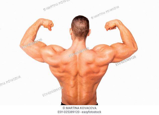 Sexy shirtless bodybuilder showing biceps. Health, sports and fitness