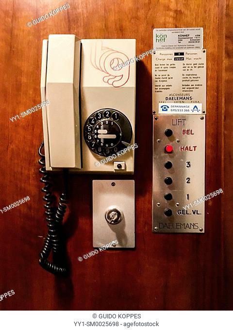Antwerp, Belgium. Old Skool Telephone inside a residential elevator
