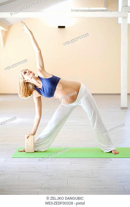 Prenatal yoga, woman doing triangle pose