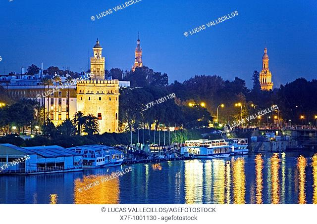 Gold tower  In the background towers of España square  Seville, Andalusia, Spain