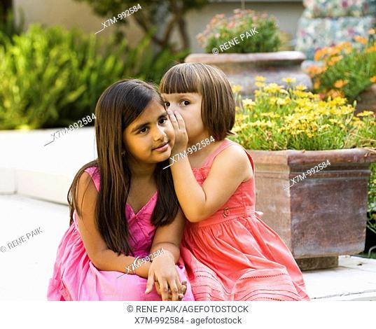 2 friends, an Asian Indian girl and a caucasian girl, share secrets