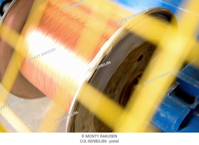 Spinning reel of copper cable in cable factory, close up