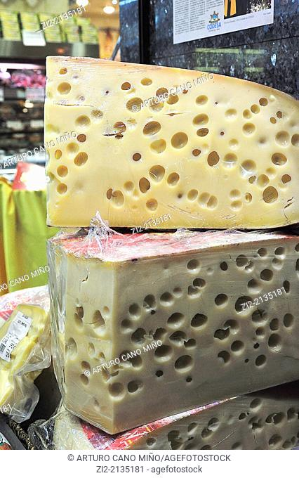 Gruyere cheese in a shop window, Madrid, Spain
