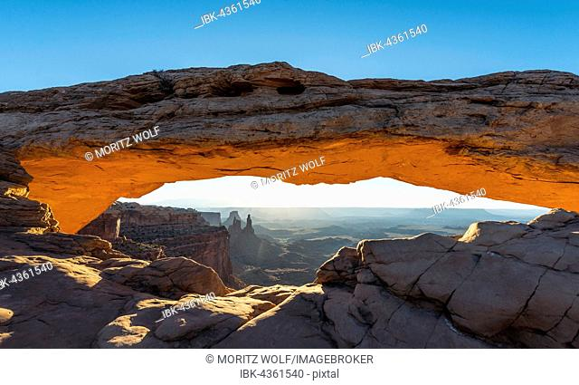 View through Natural Arch, Mesa Arch, Sunrise, Grand View Point Road, Island in the Sky, Canyonlands National Park, Moab, Utah, USA