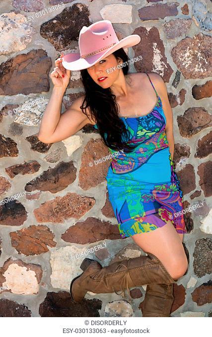 Pretty mature Eurasian woman in a blue dress