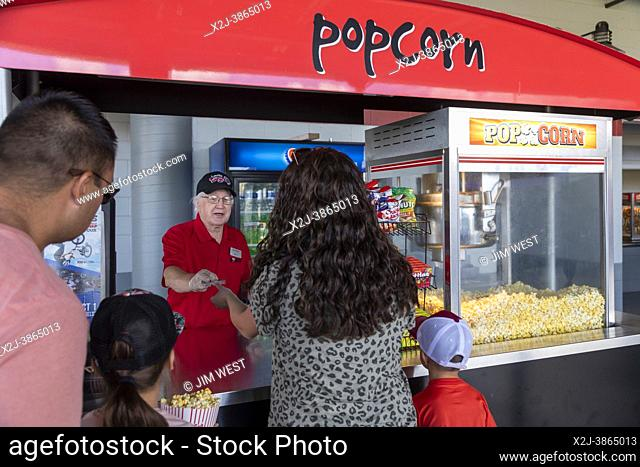 Lansing, Michigan - A vendor takes a credit card for popcorn payment at Jackson Field during a Lansing Lugnuts baseball game