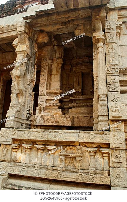Carvings on the right side of the North Gopura of the inner courtyard, Achyuta Raya temple, Hampi, Karnataka, India. Sacred Center