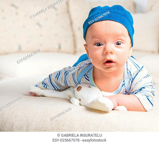 Cute 2 months old baby boy at home on the sofa