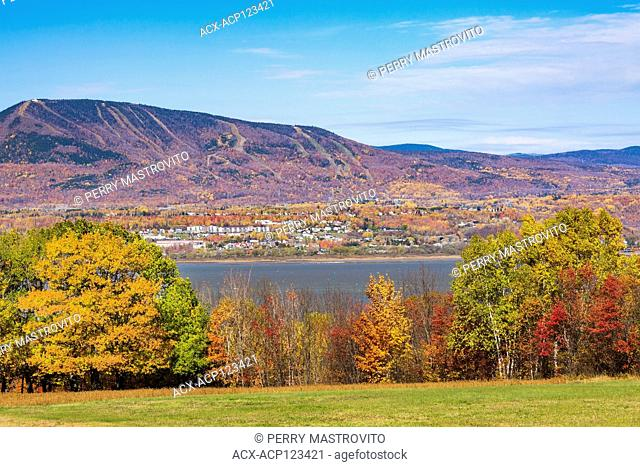 View from Ile d'Orleans of Saint-Lawrence river and Saint-Ferreol-les-Neiges village with Mont-Sainte-Anne in the background in autumn