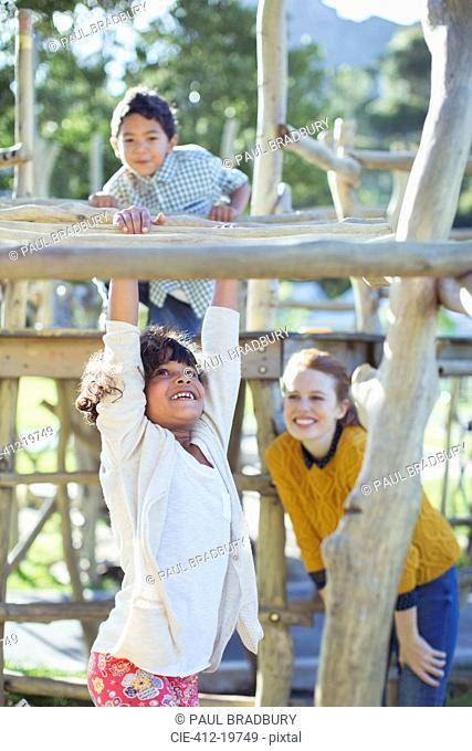 Teachers and students playing on play structure