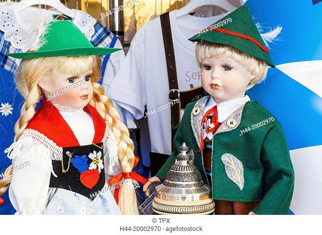 Germany, Bavaria, Munich, Souvenir Shop Window Display of Dolls in Bavarian Costume