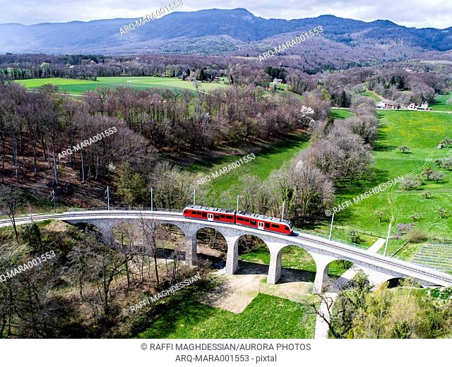 Aerial view of train on viaduct