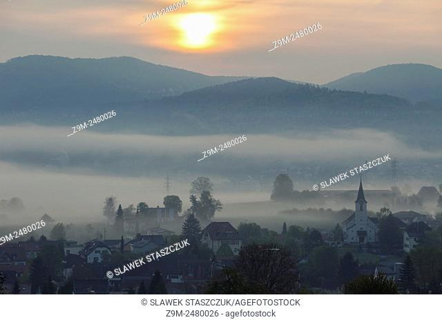 Misty spring dawn in Wahlen near Laufen, canton of Basel-Country, Switzerland. Jura Mountains